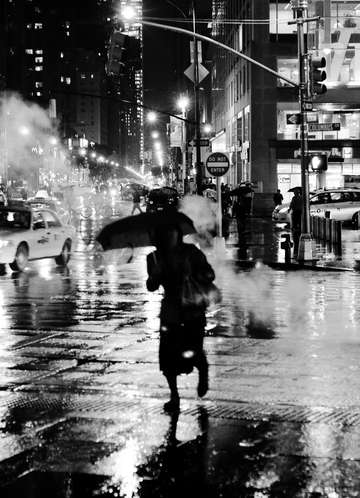 Woman in rain black and white