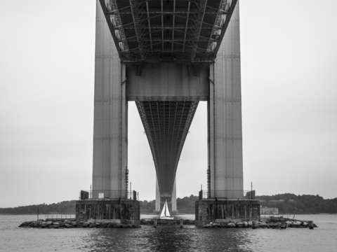 Sailboat under the verrazzano narrows bridge