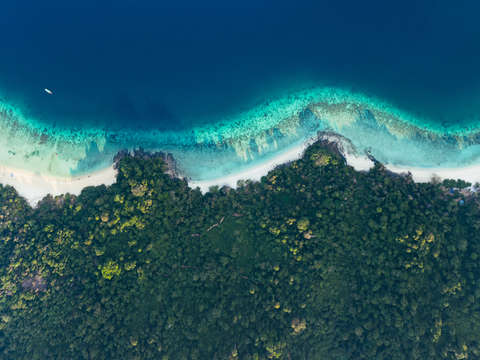Aerial view of tropical island beach and coral r 2