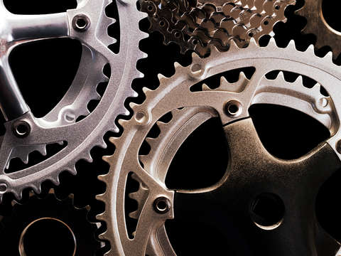 Bicycle gears on black background