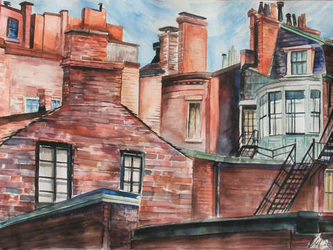 Orange and red chimneys under a pale blue sky
