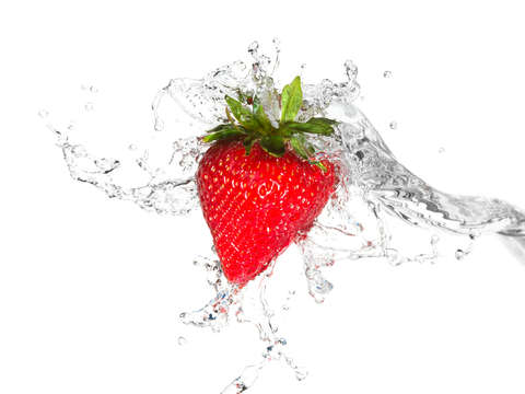 Water splashing on a strawberry
