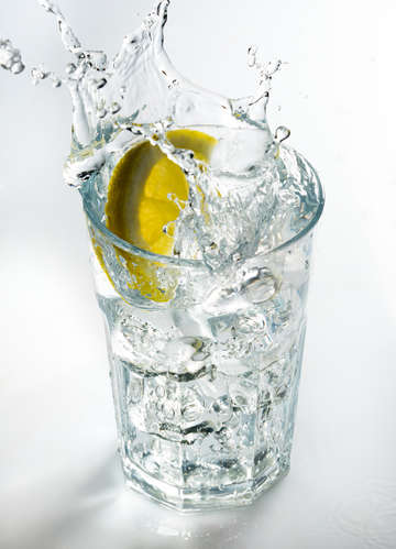 Lemon splashing on a glass