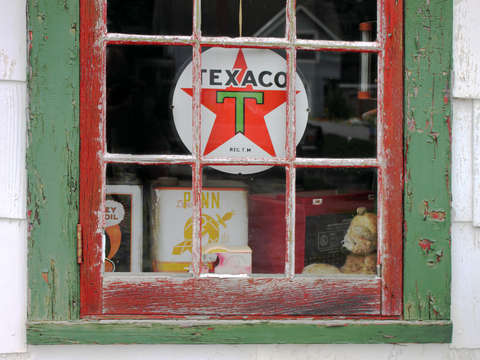 Stuck in time, an old Texaco sign adorns a window in Essex, New York