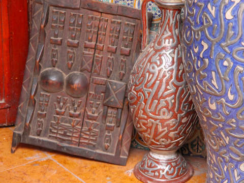 Vases and wooden shutter